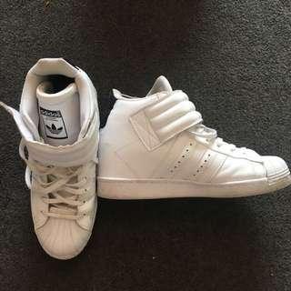 Adidas white heel high tops
