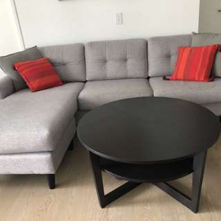 Gray sofa and brown table