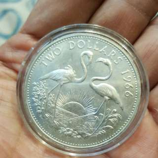 Two dollar 1966 BAHAMA ISLAND silver coin.