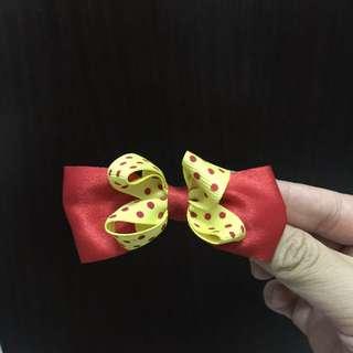 jepit pita merah kuning