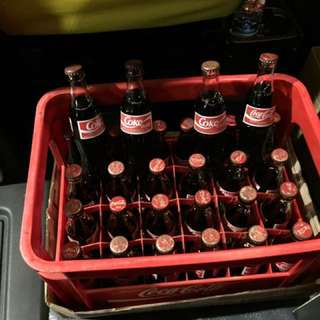 Unopened, 28 Coca Cola drink bottles in crate