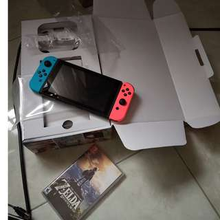 Selling Nintendo switch with breath of the wild and protective accessories