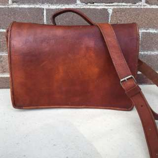 Leather satchel with long strap and handle
