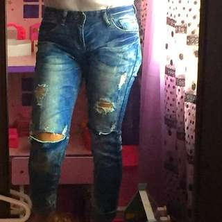 Tattered rip jeans