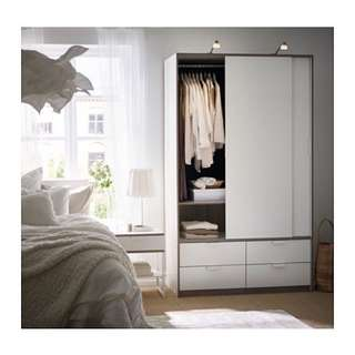 TRYSIL wardrobe with sliding doors / 4 drawers.  118x61x202 cm
