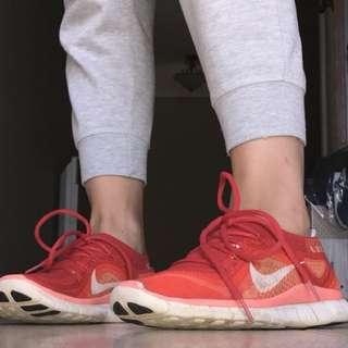 Nike red free runs
