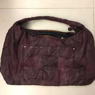 100%真皮紫紅色側孭袋