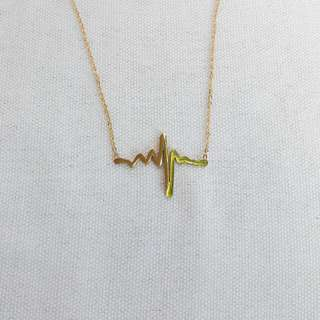 Stainless/non-tarnish heartbeat pendant necklace
