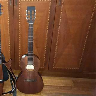 Petite guitar with carrying cover case. Ive loaded more pictures with details.  Made in japan. Steel strings  Davis brand
