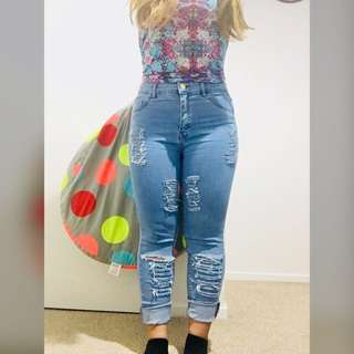 High waisted Ripped Jeans size 10
