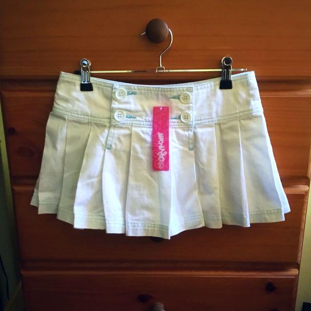 White button mini skirt