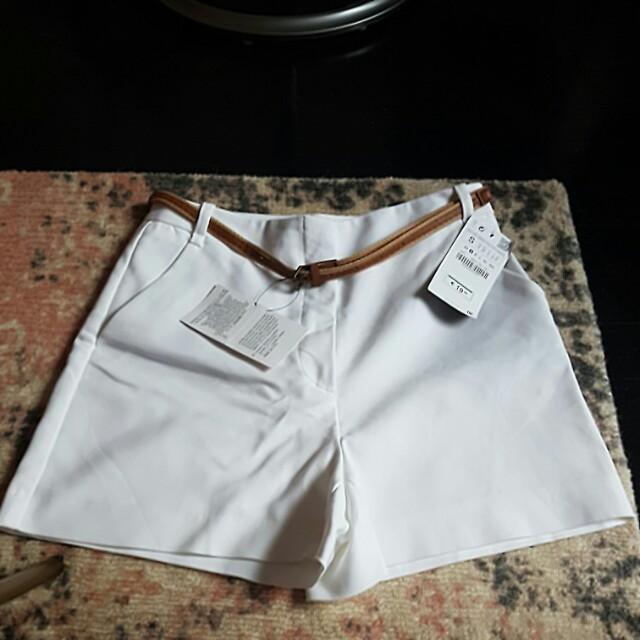 White shorts and belt