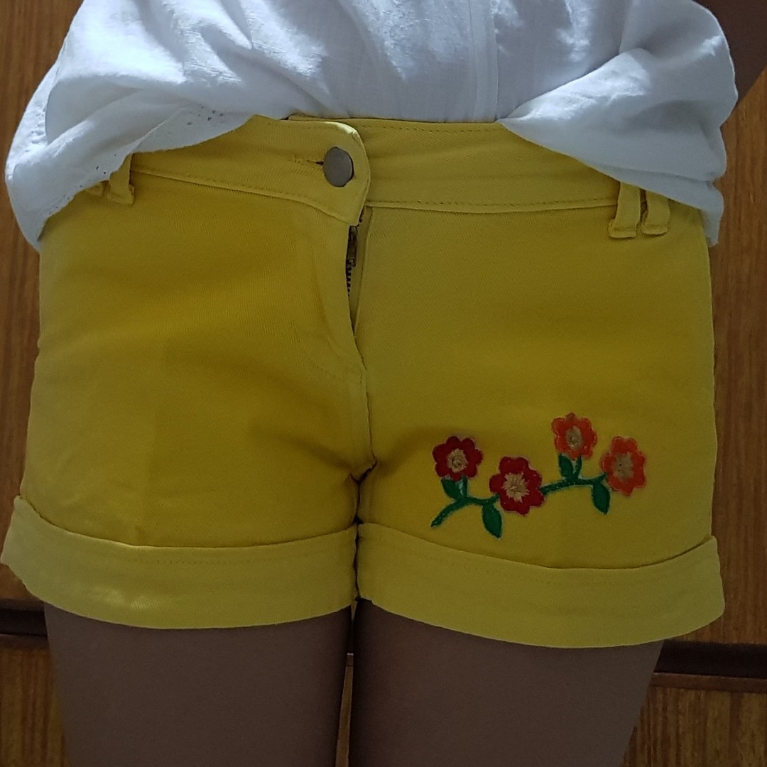 Yellow embroidered shorts