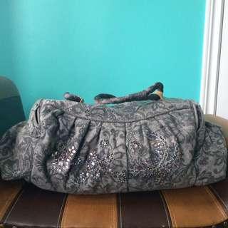 Embellished duffel bag