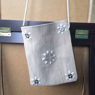 Cross body cloth sea shell embellished bag