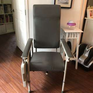 Geriatric chair with attachable table