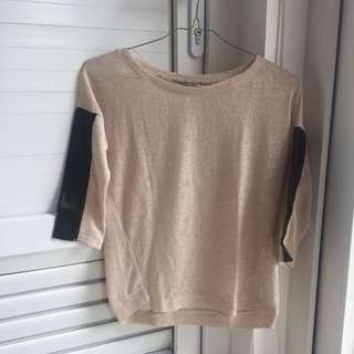 Knitted top with leather sleeve