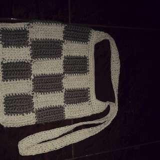 Medium sling bag black and white.