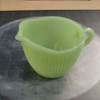 Fire King jadeite vintage milk pitcher. Made in USA, Having a little chip.
