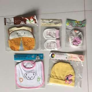 Assorted baby bibs, mittens, booties, beanie
