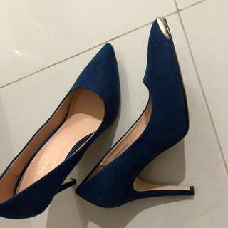 Blue Heels with metal tips