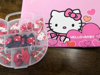 Hello kitty hairclip set attached with hello kitty paper bag