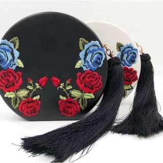 Round shape embroidered tasseled handbag by LYLLOU PARIS