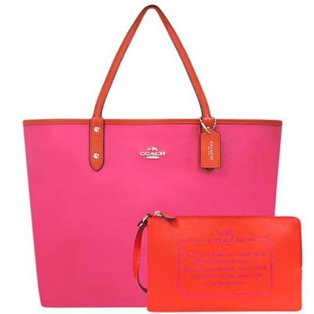 COACH 桃紅色防刮皮革雙面托特包-附大型手拿包