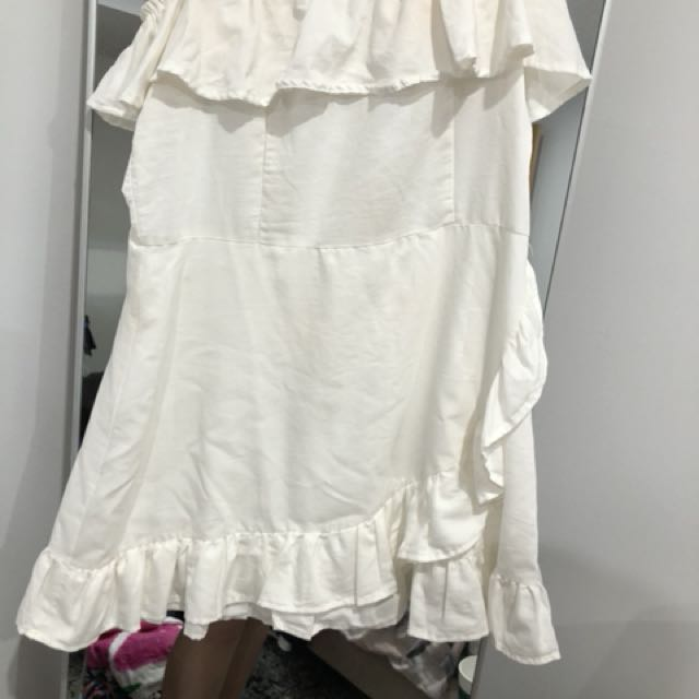 White frill of the shoulder dress