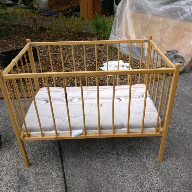 Wooden folding cot with mattress
