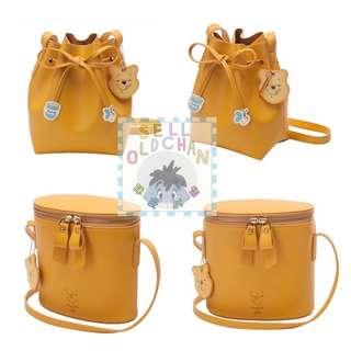 [#陳皮代購 ] 台灣代購小熊維尼壓紋雙拉鍊圓筒側背包及綁結束繩水桶包
