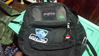 JANSPORT  black faded with patches