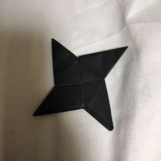 Black origami ninja star
