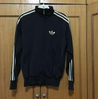 Adidas Black and gold jacket