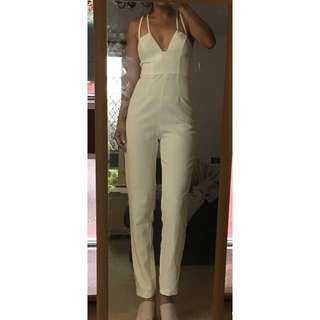 Flattering white jumpSuit. Brand new with tags. Size 8