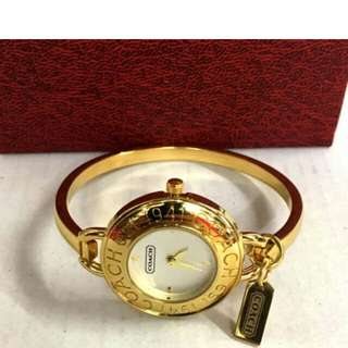 Coach gold watch