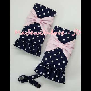 Padded drool pad with bow and ruffles for baby carrier