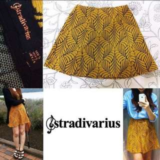 STARDIVARIUS YELLOW GEOMETRIC SKIRT