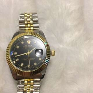 Black and gold Rolex Watch