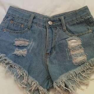 Light blue frayed hem distressed shorts