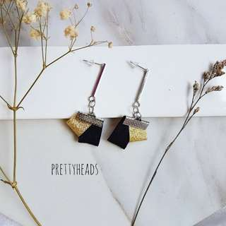 Stick earrings with black and gold ribbons