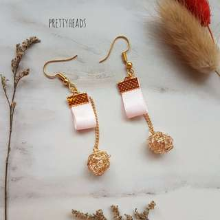 Gold earrings with pink ribbon and crystal encased charms