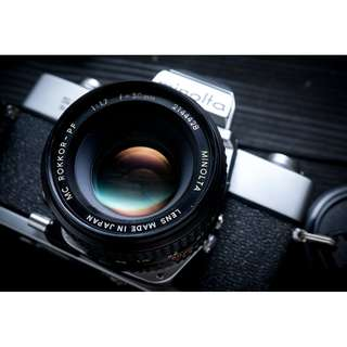 Minolta SRT Super SLR vintage film camera with 50mm lens rokkor lens