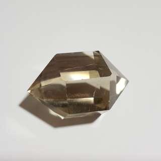 Polished hexagonal smoky quartz