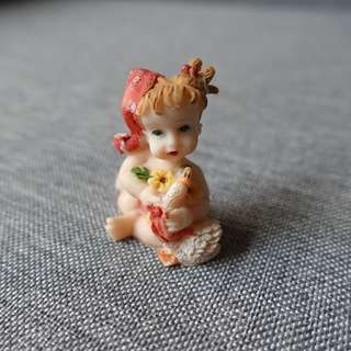 Baby with Flowers Figurine