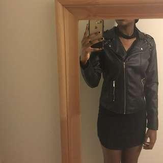 Selling black faux-leather jacket!