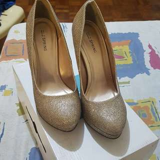 Call it spring. Gold high heels. Only used once With box. Good as Brand New