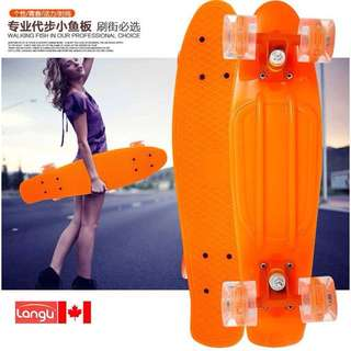 Orange Penny Style Skateboard with Lighted Wheels