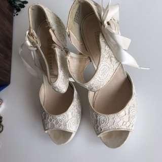 White stiletto shoe