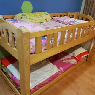 Solid pinewood bunk beds with storage drawers